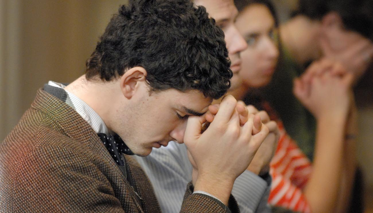 A young man prays during a novena in 2010 at The Catholic University of America in Washington. The Knights of Columbus is urging its members and other U.S. Catholics to pray a novena from Oct. 30 to Nov. 7, the eve of Election Day. (CNS photo/Rafael Crisostomo, El Pregonero)