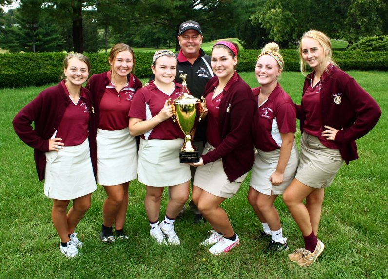 The Little Flower team, coached by Michael J. Fox, took home the girls' Catholic League golf championship trophy.