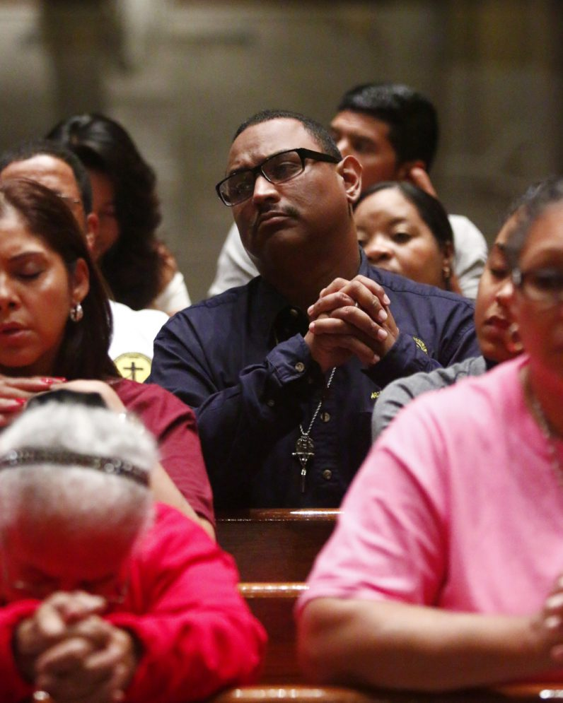 Luis Raul Oquendo, president of the John 23rd movement and parishioner of St. Veronica Parish in Philadelphia, prays during Mass.