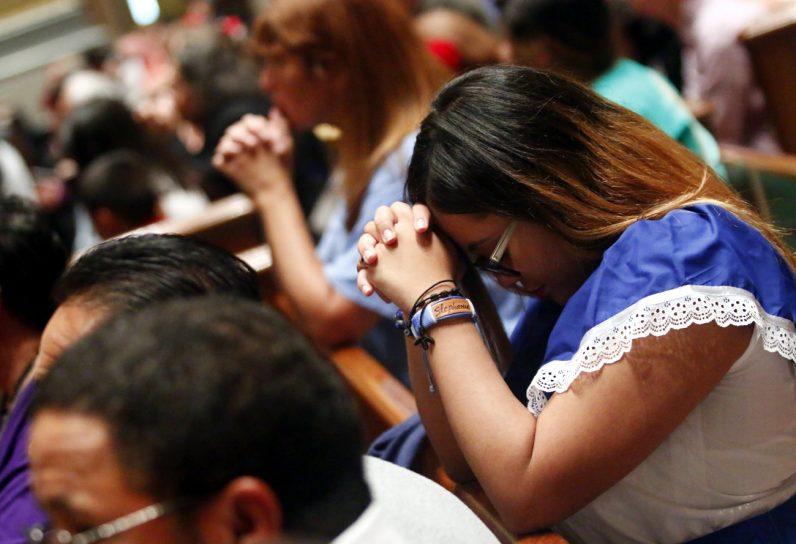 Stephanie Euceda-Nunez, parishioner of St. Martin of Tours, prays during the Hispanic Heritage Mass. Stephanie is of Honduran heritage.