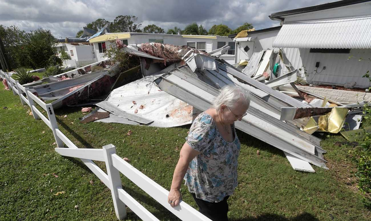 Cherie Monroe pauses after looking at the roof of her home Oct. 9 in the aftermath of Hurricane Matthew in Port Orange, Fla. (CNS photo/Phelan Ebenhack, Reuters)