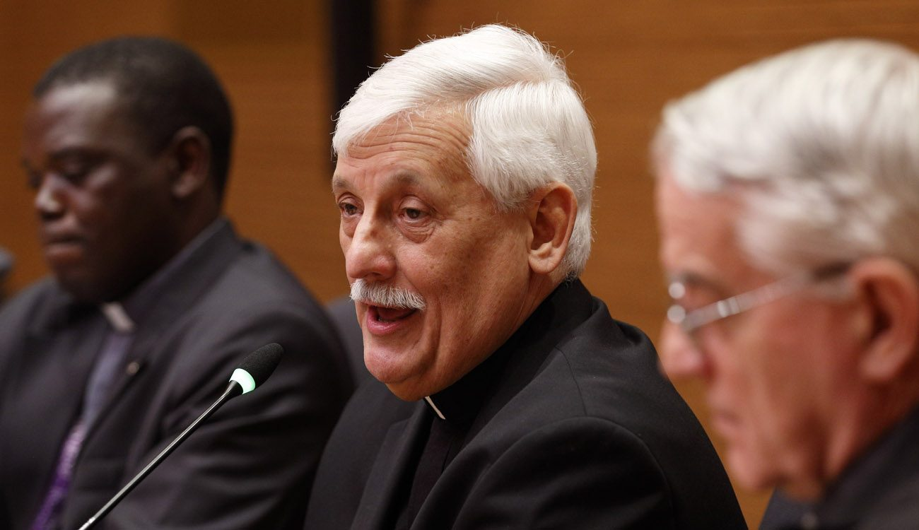 Jesuit Father Arturo Sosa Abascal, the new superior general of the Jesuits, speaks at a press conference in Rome Oct. 18. Also pictured are Jesuit Father Patrick Mulemi, director of the Jesuits' Rome communications office, and Jesuit Father Federico Lombardi, former Vatican spokesman. (CNS photo/Paul Haring)