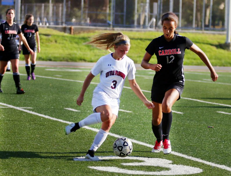 Little Flower senior Cailey Plath takes control of the ball.
