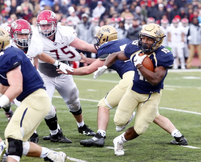 La Salle senior running back Syaire Madden makes a cut to gain yards.