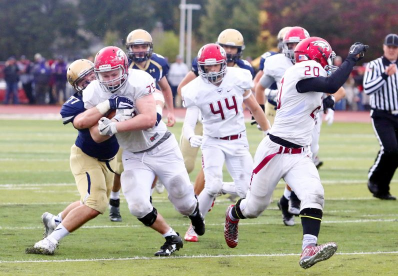 Ryan Bryce gains yardage for the Prep after grabbing a La Salle turnover.
