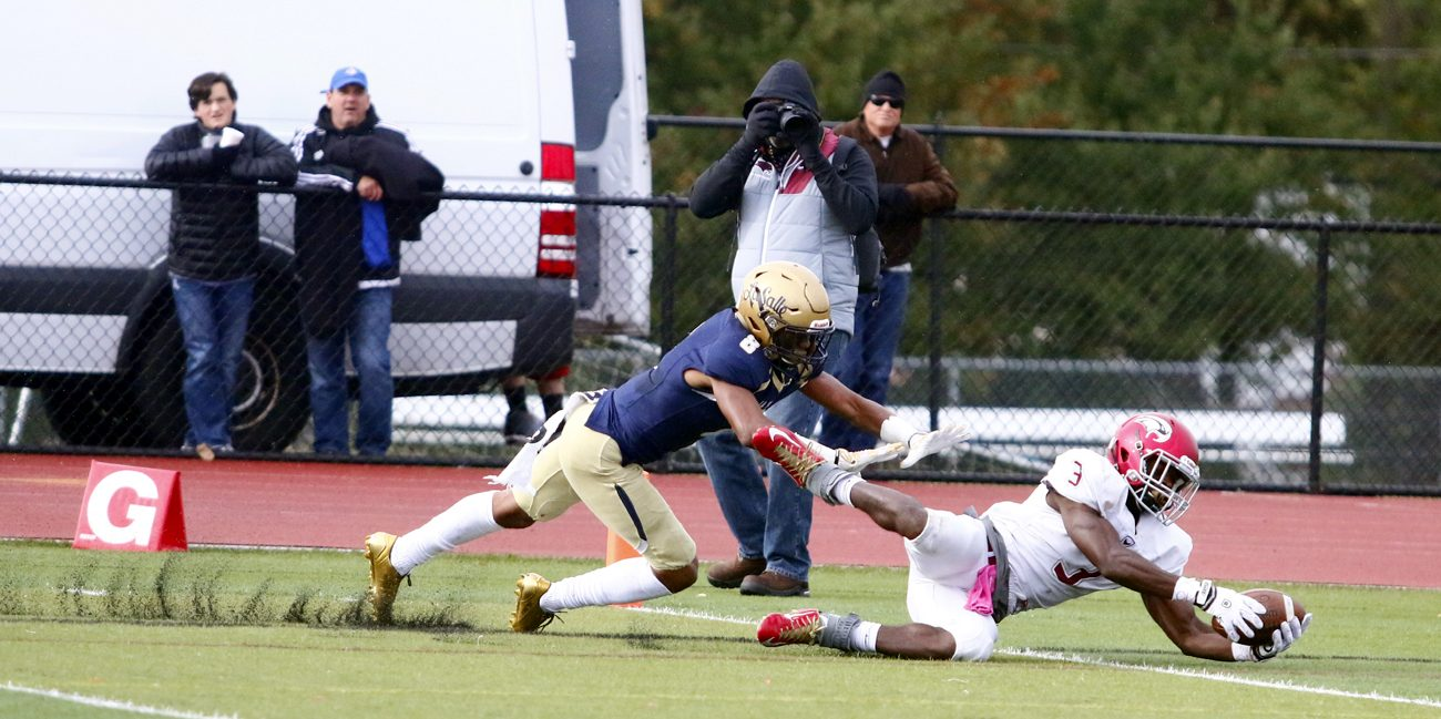 St. Joseph's Prep wide receiver Terrance Greene stretches across the goal line with La Salle's Tre McNeill on his heels during a game Oct. 22 that clinched the Catholic League championship for the Prep. Both players were named All-Catholics in their position.