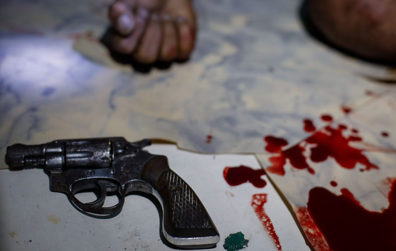 A hand gun is seen next to blood stains near the body of an alleged drug dealer who was killed in a police operation in Manila, Philippines, in early July. The Archdiocese of Manila officially launched a drug rehabilitation program Oct. 23, with a heavy emphasis on spiritual formation in the wake of the Philippine government's war on drugs. (CNS photo/Mark R. Cristino, EPA)