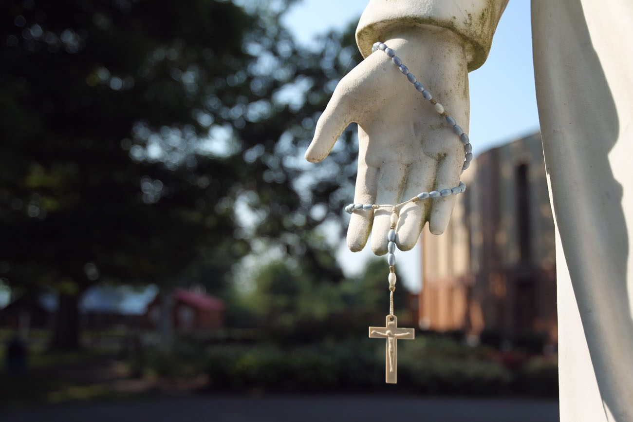 A rosary hangs from a statue of Jesus at the Shrine of Our Lady of Martyrs in Auriesville, N.Y., in this 2010 file photo. (CNS photo/Nancy Wiechec)