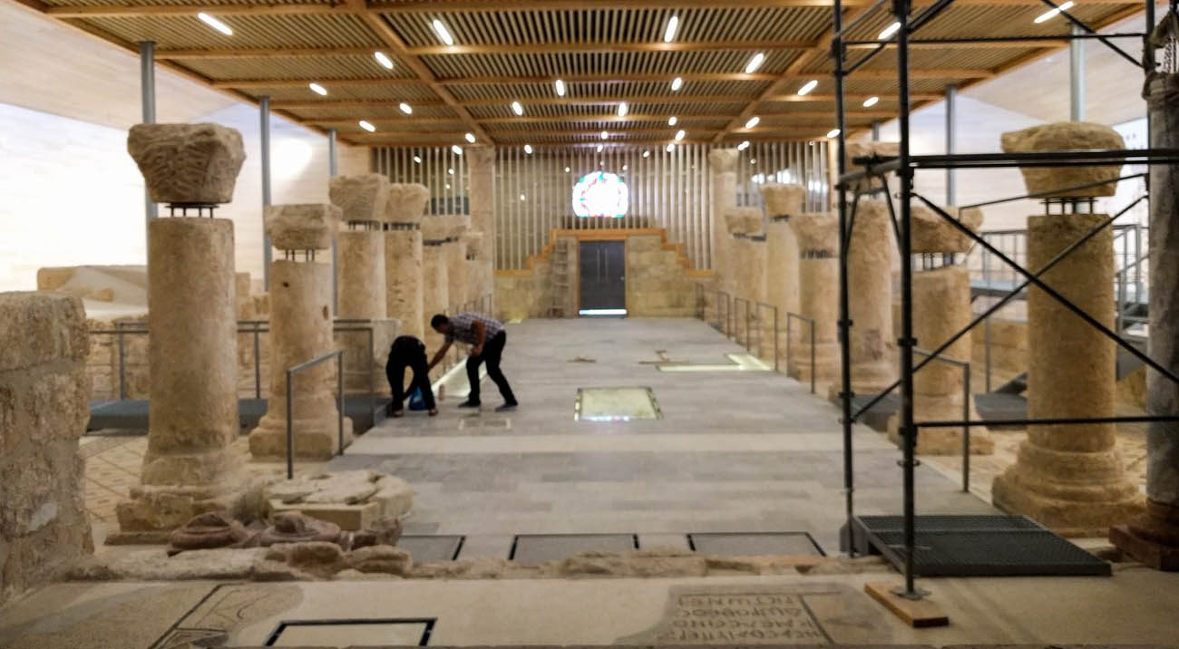 Workers make final preparations in this interior view of the restored Memorial of Moses on the top of Mount Nebo in Jordan Oct. 10. The memorial has reopened its doors to the public amid festivities after a nearly decade of restoration. (CNS photo/Greg Tarczynski)