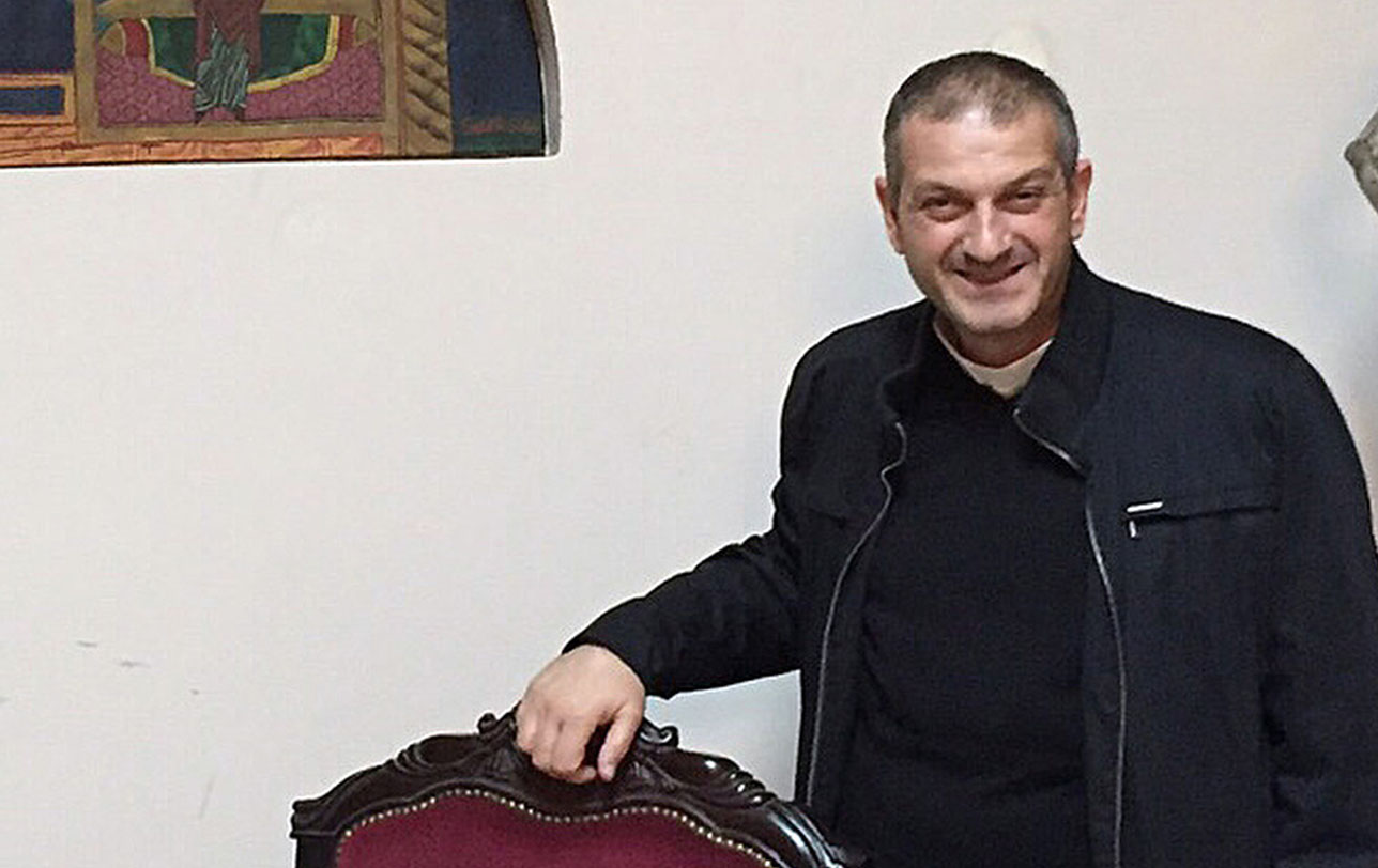 Father Jacques Mourad poses for a photo Nov. 11, 2015 in the reception area at Our Lady of the Annunciation Church in Beirut. The Syriac-Catholic priest, who was held captive by the Islamic State group for nearly five months in 2015, called on Canada to undertake diplomatic steps to end the Syrian civil war. (CNS photo/Doreen Abi Raad)