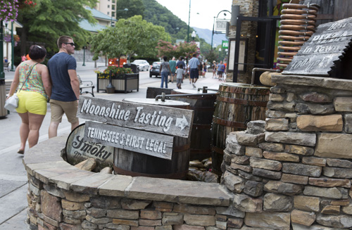 Visitors walk by some of the main attractions Aug. 13 in Gatlinburg, Tenn., a city by the entrance of the Great Smoky Mountains National Park. (CNS photo/Chaz Muth)