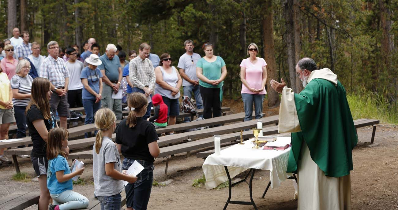 Jesuit Father Rick Malloy celebrates Sunday vigil Mass in Yellowstone National Park in Wyoming Aug. 6. (CNS photo/Nancy Wiechec)