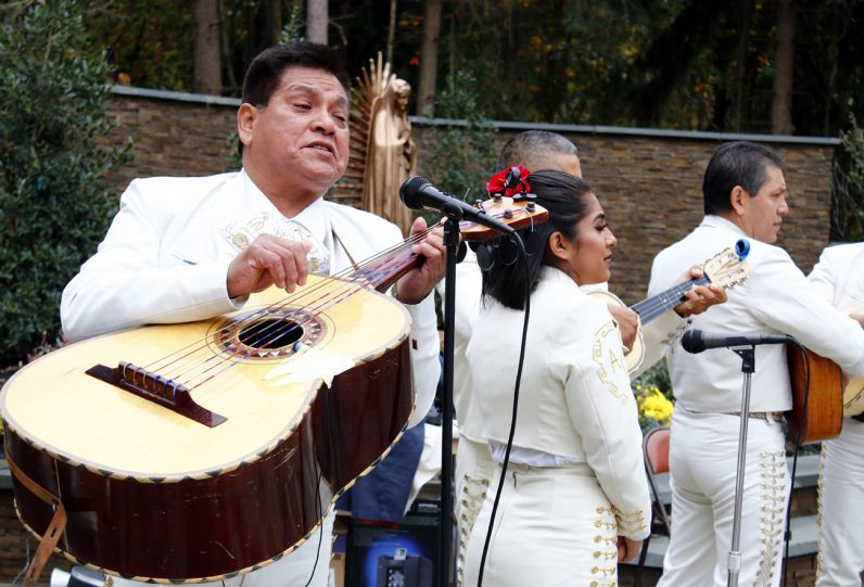 The band Mariachi Flores provides music for the dedication.