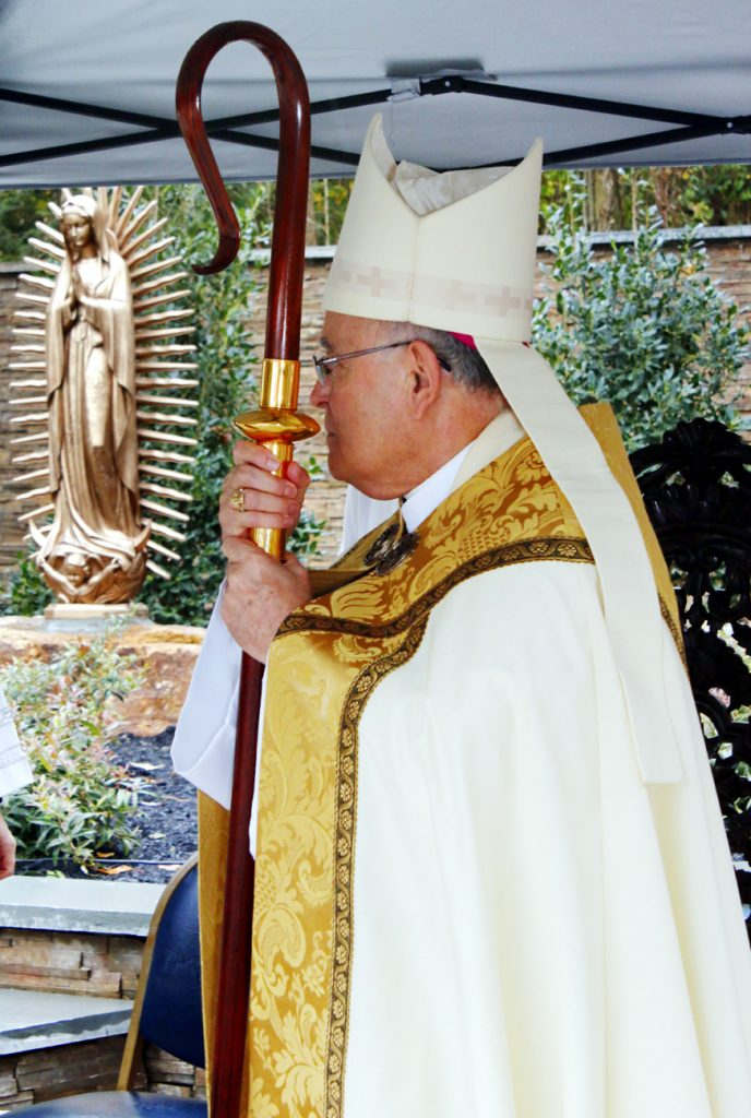 Archbishop Chaput listens to the Gospel reading Oct. 22 at the dedication and blessing ceremony of the new Our Lady of Guadalupe Shrine at Malvern Retreat House.