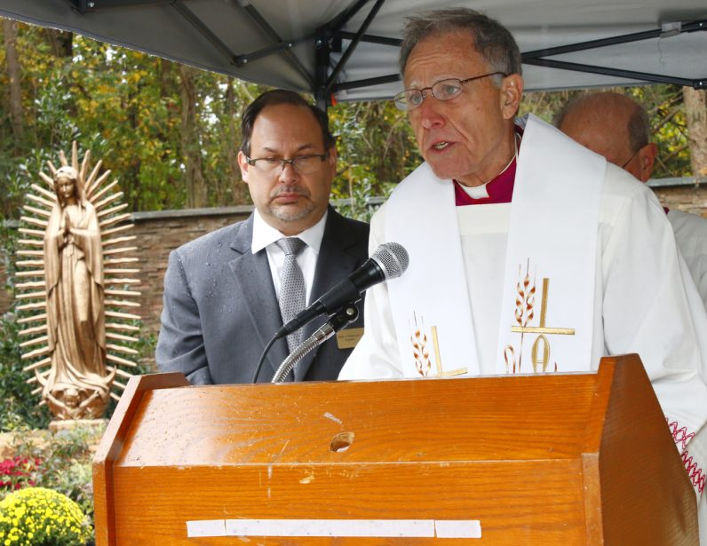 Msgr. Joseph Marino, rector of Malvern Retreat House,  proclaims a reading from the Gospel as Mark Pultenow, executive director, listens.