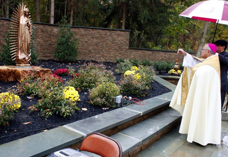 Archbishop Charles Chaput incenses the Shrine of Our Lady of Guadalupe at Malvern Retreat House.