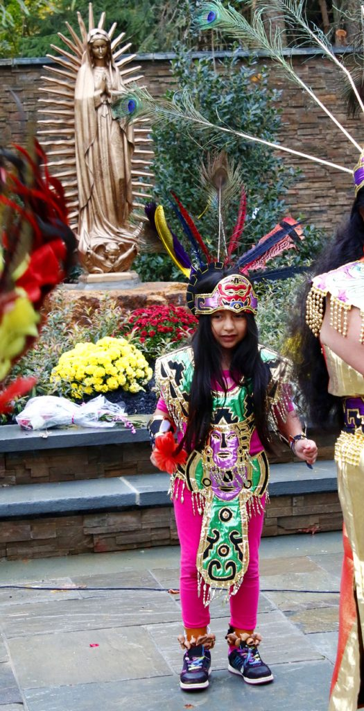 A young folk dancer from St. Mark Parish in Sea Grit, N.J., performs in front of the Our Lady of Guadalupe Shrine.