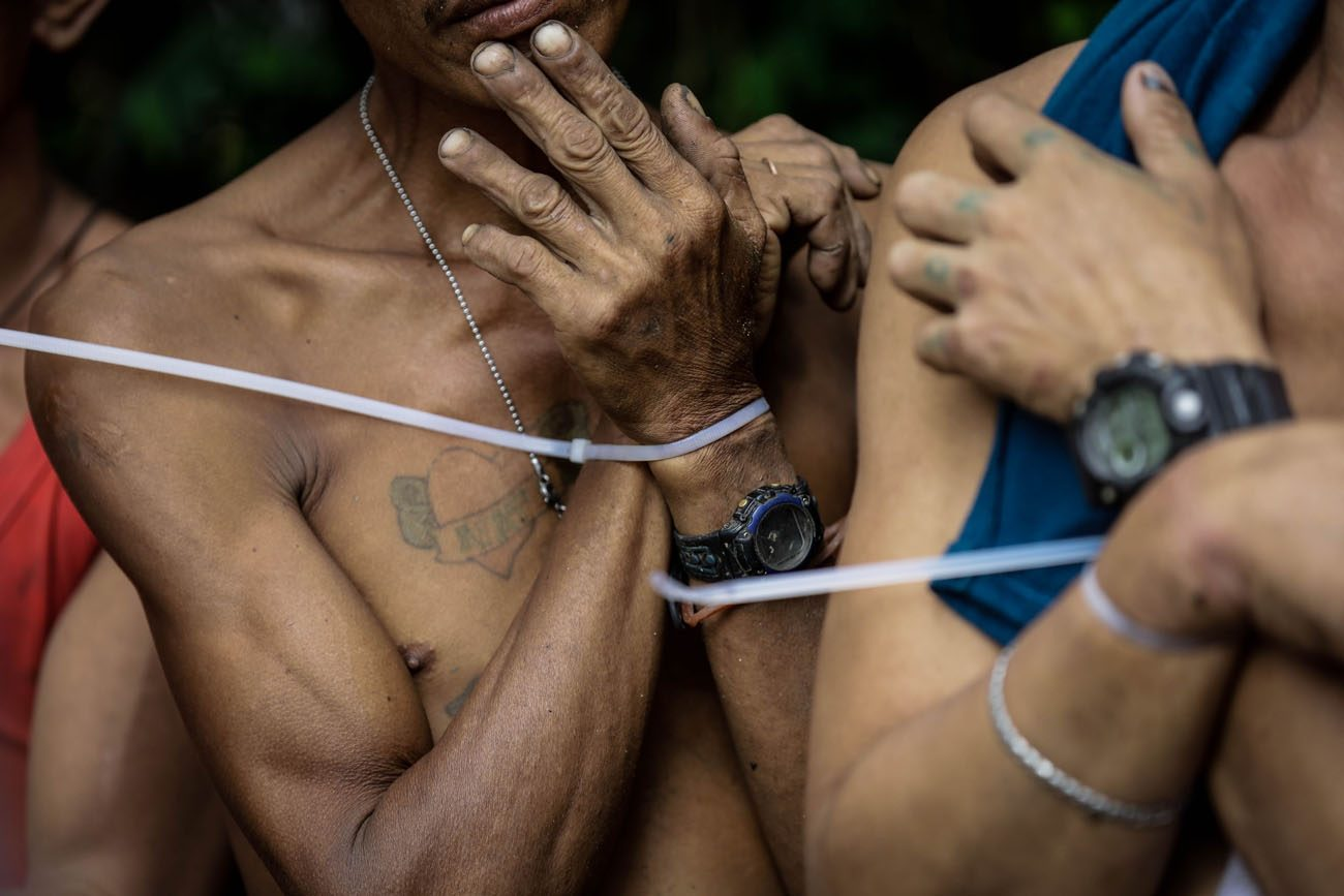 Alleged drug users are arrested with zip ties during a police operation in Quezon City, Philippines, Oct. 5. (CNS photo/Mark R. Cristino, EPA)