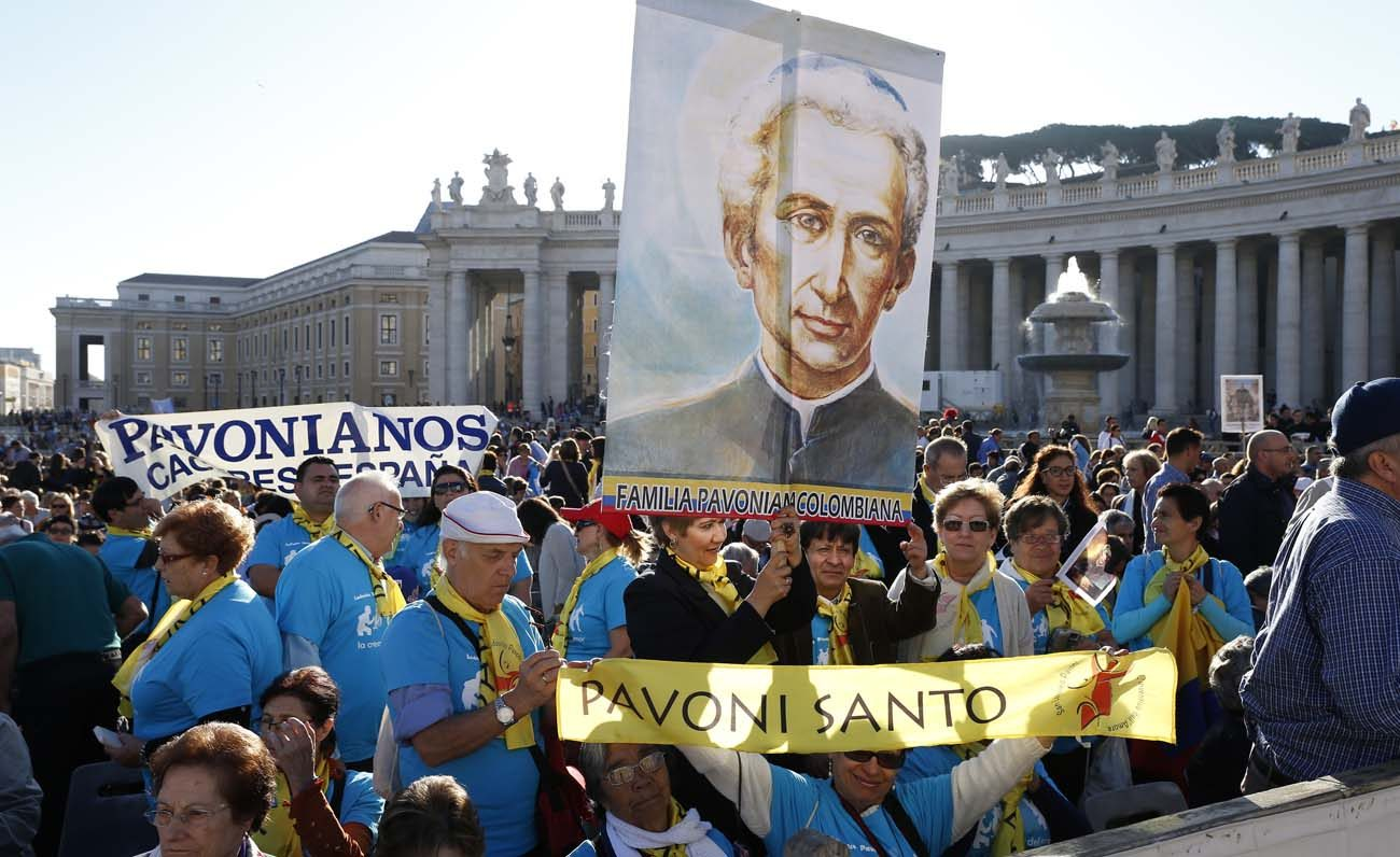 Pilgrims hold a banner of new St. Ludovico Pavoni before  the canonization Mass for seven new saints celebrated by Pope Francis in St. Peter's Square at the Vatican Oct. 16. (CNS photo/Paul Haring)
