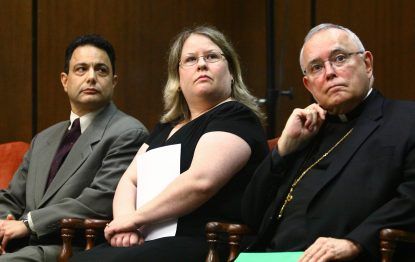 From left, Peter Sciarra, Denise Kelly and Archbishop Charles Chaput hear details about Project Rachel in the Philadelphia Archdiocese. (Sarah Webb)