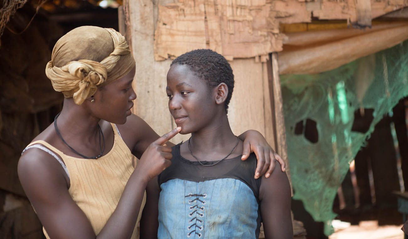 "Lupita Nyong'o and Madina Nalwanga star in a scene from the movie ""Queen of Katwe."" (CNS photo/Disney)"