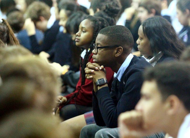 Darius Turner from Cardinal O'Hara High School listens intently to keynote speaker Leah Darrow.