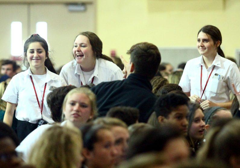 From left, Alyssa Kapral, Alyssa Bergmark and Lauren Webster from Archbishop Ryan High School enjoy the retreat.