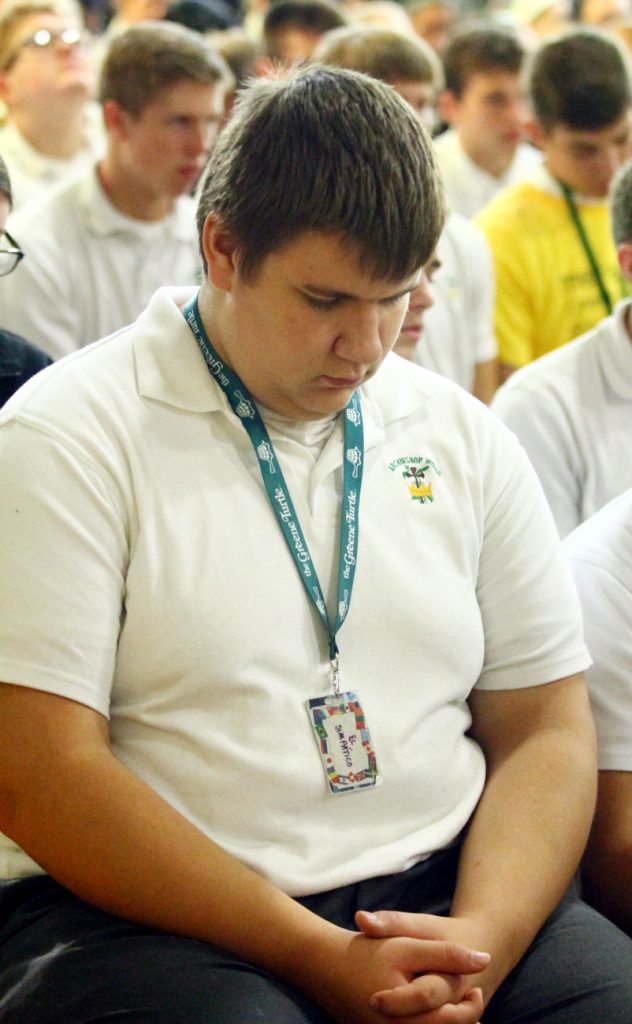 Steven Rimdzius from Archbishop Wood High School prays during adoration.