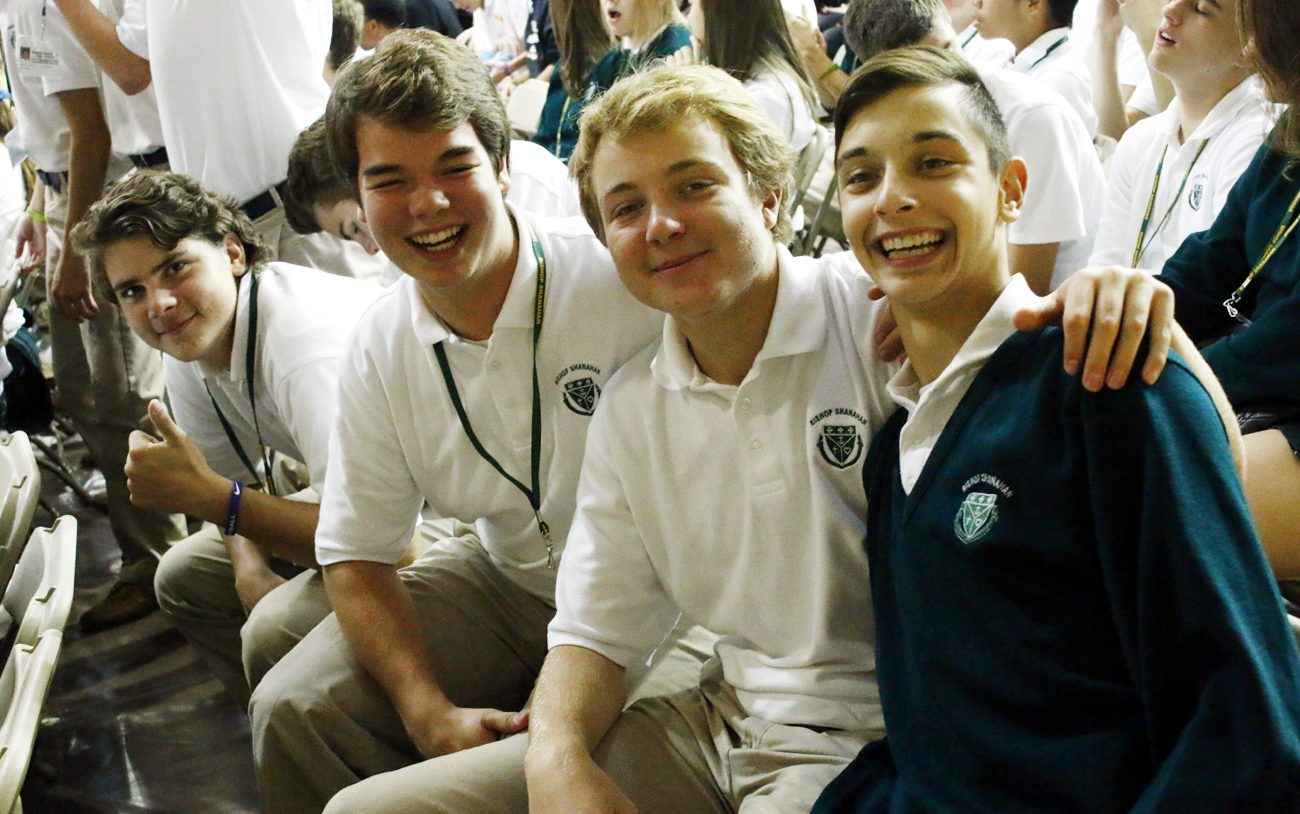 The young men from Bishop Shanahan High School give the retreat a thumbs up. (Sarah Webb)