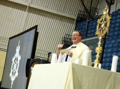 Father Stephen DeLacy leads the students in eucharistic adoration.