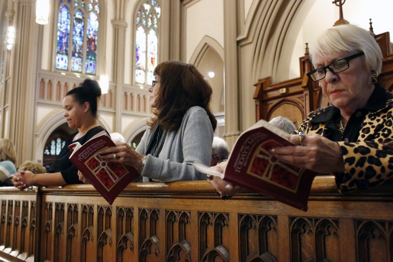 Parishioners  follow the liturgy with missalettes at St. Matthew Church, Conshohocken.
