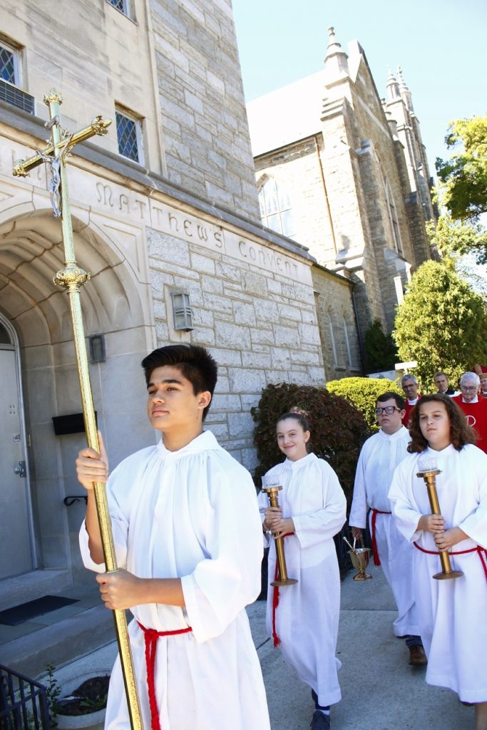 After Mass the altar servers lead the congregation to the new parish center for the blessing and celebration.