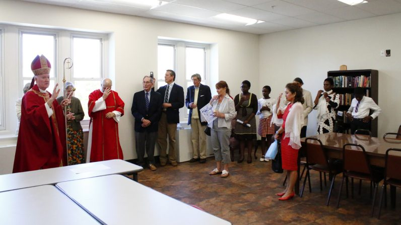 Bishop Michael Fitzgerald blesses the Mary Ann Lewis Room for New Evangelization. Lewis, now deceased, donated a large religious book collection to the parish.