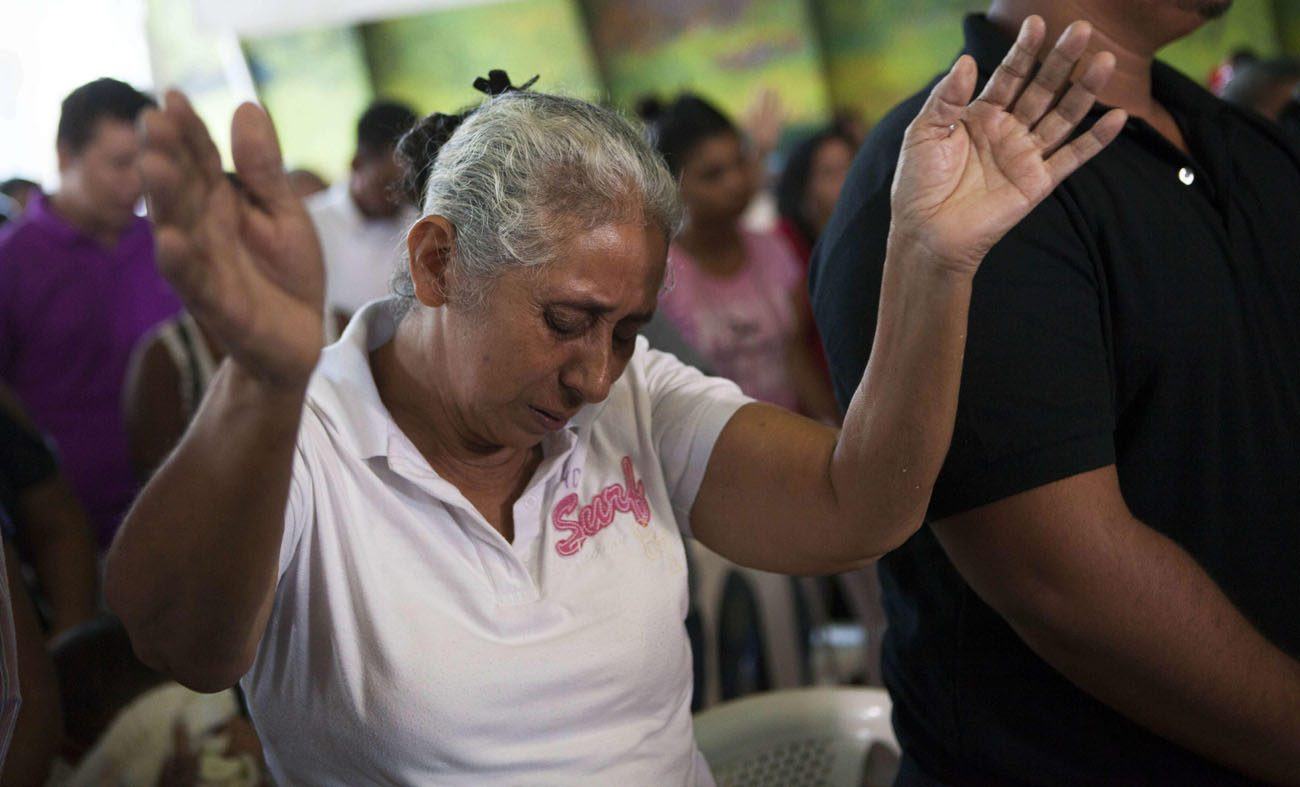 Lidia Tercero, whose son is on death row in Huntsville, Texas, prays during Mass in Managua, Nicaragua, in 2015 after her son, Bernardo, received a stay of execution. He was convicted of murdering a high school teacher while robbing a dry cleaning store in 1997. The Catholic bishops of Texas Oct. 10 called for the abolition of the death penalty.(CNS photo/Mario Lopez, EPA)