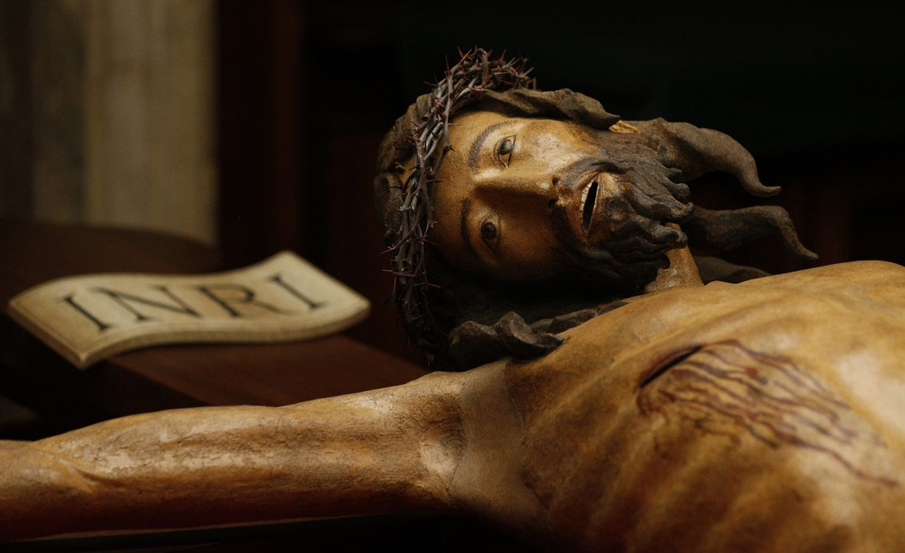 A wooden crucifix from the 14th century is pictured during a media opportunity to showcase its restoration in St. Peter's Basilica at the Vatican Oct. 28. The crucifix is one of the few items that was present in the original St. Peter's Basilica. The restoration was funded by the Knights of Columbus. (CNS photo/Paul Haring)
