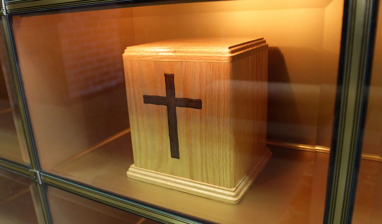 An urn containing cremated remains is seen in a niche in the Holy Rood Cemetery mausoleum in Westbury, N.Y., in 2010. During an Oct. 25 news conference in Rome, Cardinal Gerhard Muller, prefect of the Congregation for the Doctrine of the Faith, said that while the Catholic Church continues to prefer burial in the ground, it accepts cremation as an option, but forbids the scattering of ashes or keeping cremated remains at home. (CNS photo/Gregory A. Shemitz)