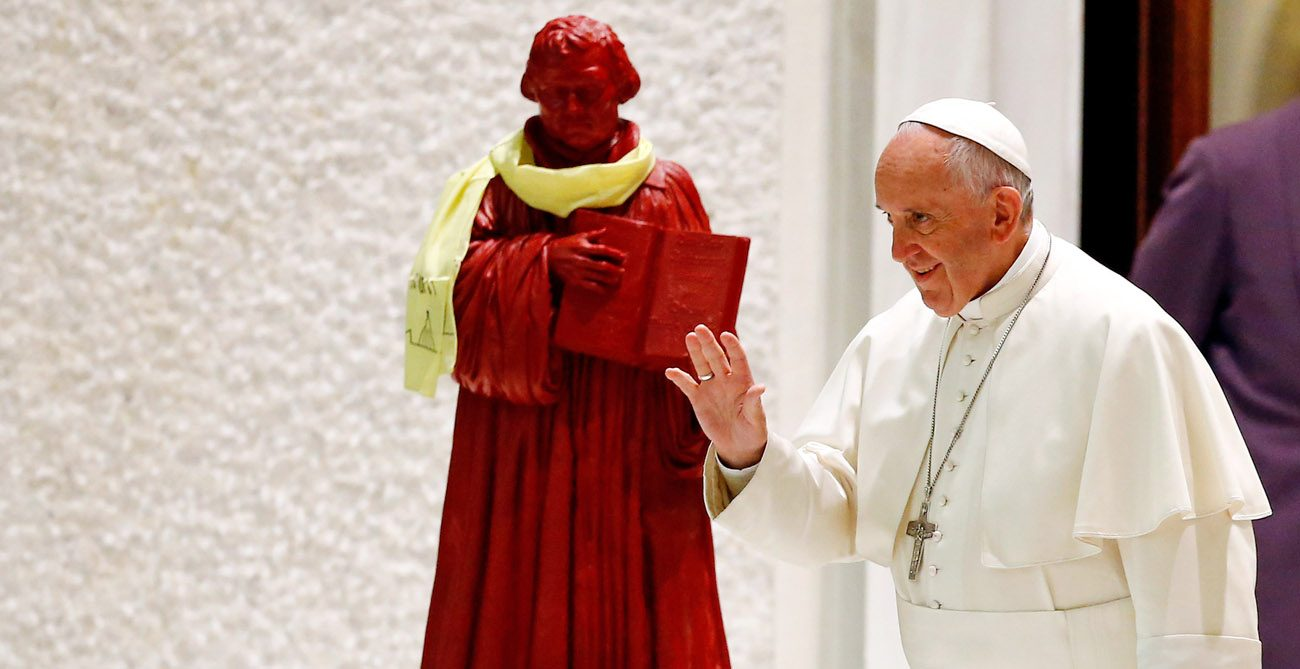 A statue of Martin Luther is seen onstage as Pope Francis arrives for an audience with a pilgrimage of Catholics and Lutherans from Germany in the Paul VI hall at the Vatican Oct. 13. The pope will visit Sweden Oct. 31-Nov. 1 for commemorations of the 500th anniversary of the Protestant Reformation. (CNS photo/Stefano Rellandini, Reuters)
