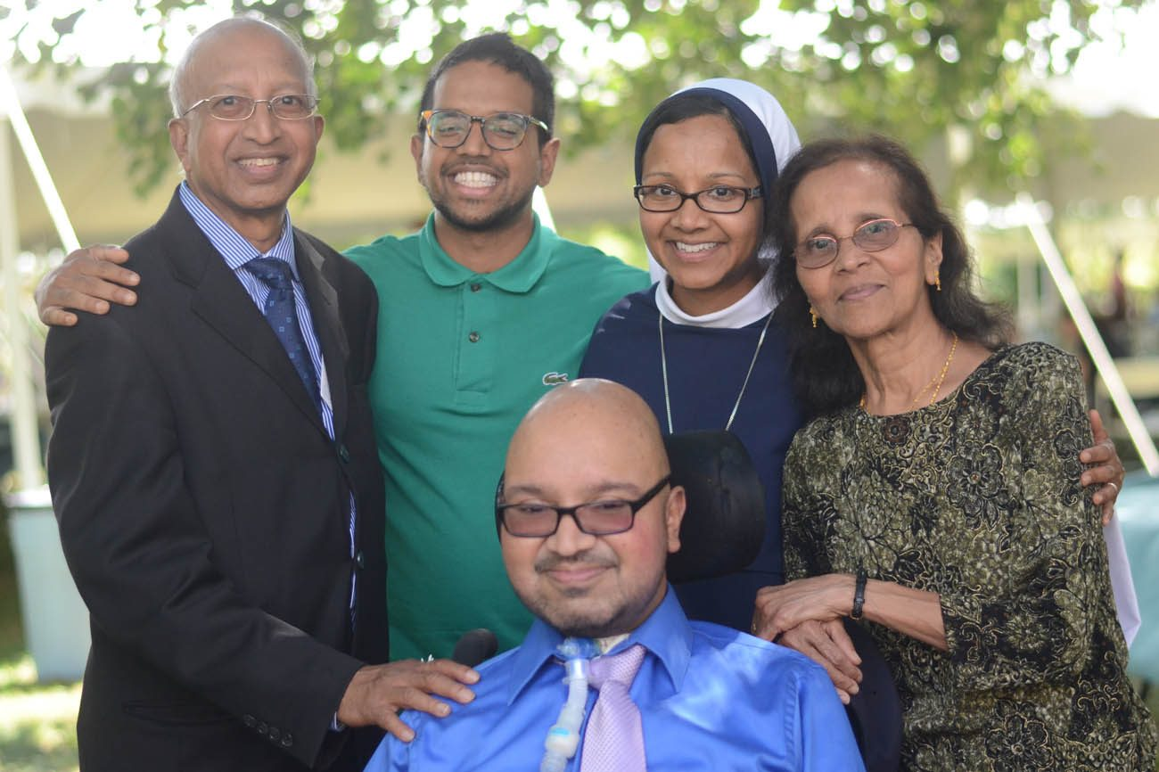 After professing her final vows as a Sister of Life Aug. 6, Sister Grace Dominic is joined by her brother Harold (in front), and at back, by her father, Henry Gomes, cousin Yves Gomes, and her mother, Dominica Gomes, at right. Sister Grace, a native of Washington, professed her vows at the Basilica of St. John the Evangelist in Stamford, Conn. (CNS photo/courtesy Sister of Life)