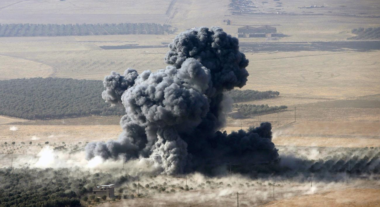Smoke rises at Islamic State militants' positions Oct. 23 in the town of Nawaran, Iraq, near Mosul. (CNS photo/Azad Lashkari, Reuters)