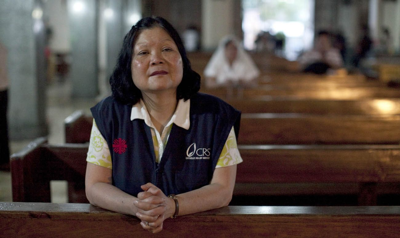 Carolyn Woo, outgoing CEO of Catholic Relief Services, reflects after a Feb. 4, 2014, Mass at a church in Tacloban, Philippines. She was visiting CRS programs assisting people affected by Typhoon Haiyan, which hit the Philippines in November 2013. Woo will end her five-year term as CEO of CRS at the end of 2016. (CNS photo/Laura Elizabeth Pohl, courtesy Catholic Relief Services)