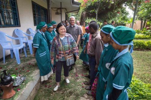 Carolyn Woo, the outgoing CEO of Catholic Relief Services, is seen preparing to greet the staff during a July 2015 visit to the CRS field office in Nazret, Ethiopia. (CNS photo/Petterik Wiggers, courtesy Catholic Relief Services)