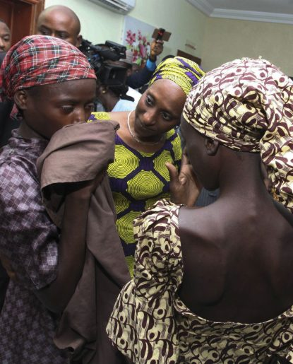 Oludolapo Osinbajo, wife of Nigerian Vice President Yemi Osinbajo, consoles one of the 21 released Chibok girls Oct. 13 in Abuja. Three Catholic leaders welcomed the release of some of the girls kidnapped in 2014 from a school in Chibok and urged the Nigerian government to prioritize the release of the remaining girls. (CNS photo/EPA)