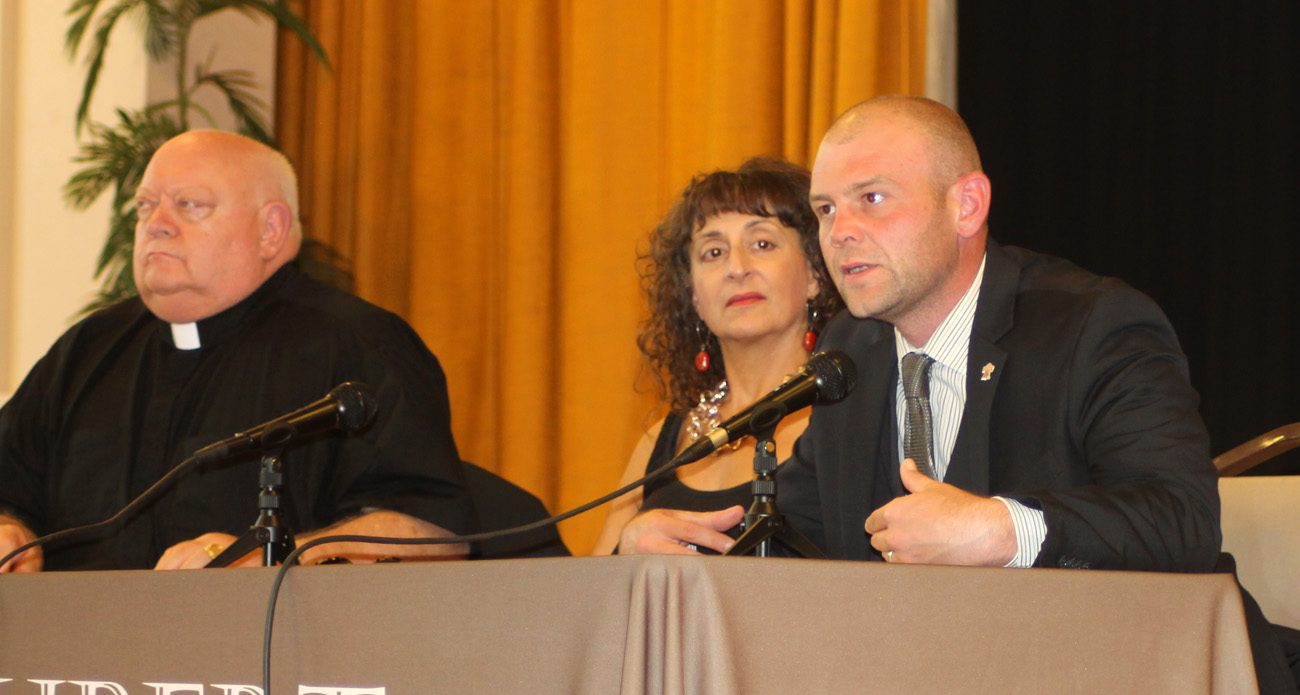 Ken Gavin (right), director of communications for the Philadelphia Archdiocese, speaks at a Sept. 28 panel discussion at St. Hubert High School reflecting on the one-year anniversary of the World Meeting of Families and visit of Pope Francis to Philadelphia in September 2015. Also on the panel were Vincentian Father Carl Pieber and professor Ada Tremonte. (Photo by Lou Baldwin)