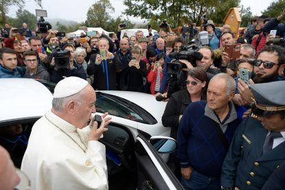 Pope Francis talks with people using a car loudspeaker as he visits the earthquake-ravaged town of Amatrice, Italy, Oct. 4. (CNS photo/L'Osservatore Romano)