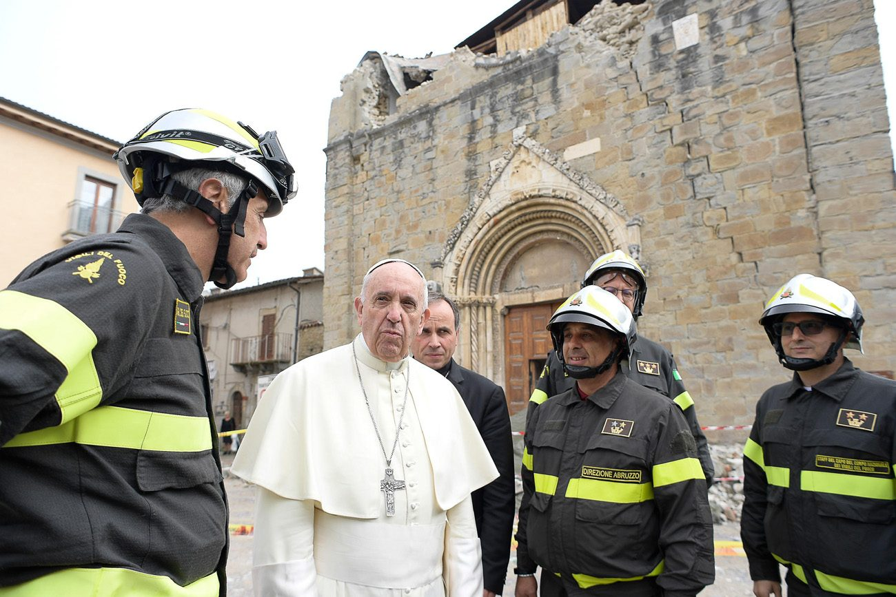 Pope Francis talks with firefighters as he visits the earthquake-ravaged town of Amatrice, Italy, Oct. 4. The town was devastated by an Aug. 24 earthquake that claimed the lives of nearly 300. (CNS photo/L'Osservatore Romano)
