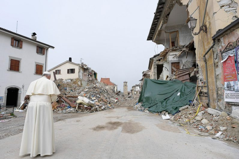 Pope Francis prays as he visits the earthquake-ravaged town of Amatrice, Italy, Oct. 4. The town was devastated by an Aug. 24 earthquake that claimed the lives of nearly 300. (CNS photo/L'Osservatore Romano)