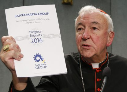 Cardinal Vincent Nichols of Westminster, England, holds a report of the Santa Marta Group during a news conference on human trafficking at the Vatican Oct. 27. (CNS photo/Paul Haring)