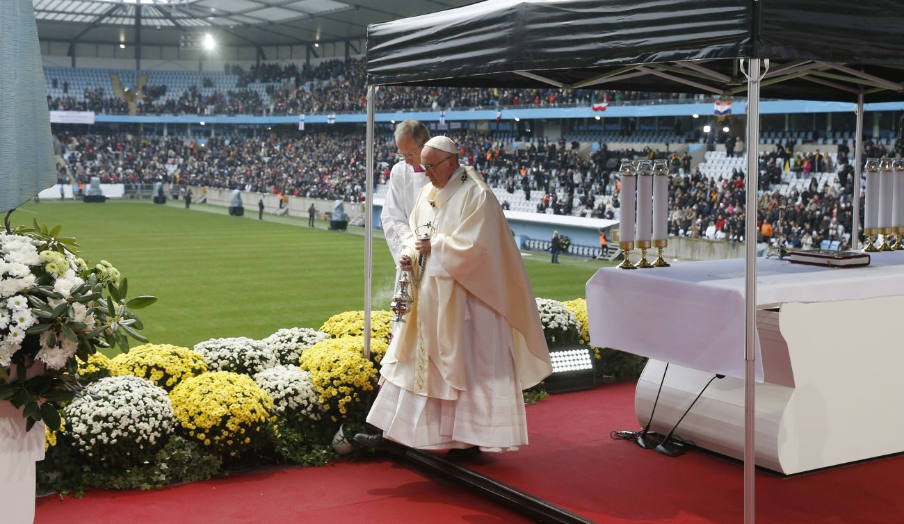 Pope Francis uses incense as he celebrates Mass at the Swedbank Stadium in Malmo, Sweden, Nov. 1. Assisting the pope is Msgr. Guido Marini, papal master of ceremonies. (CNS photo/Paul Haring)