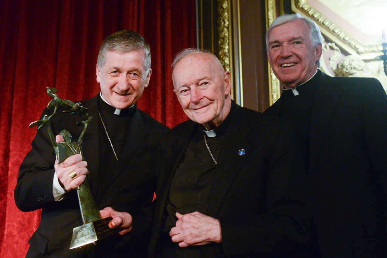 Cardinal-designate Blase J. Cupich of Chicago, who is chancellor of Catholic Extension, presents the organization's Spirit of Francis Award to Cardinal Theodore E. McCarrick, retired archbishop of Washington, at an awards dinner Oct. 27 in New York. At right is Father Jack Wall, president of Catholic Extension. (CNS photo/ courtesy Catholic Extension)