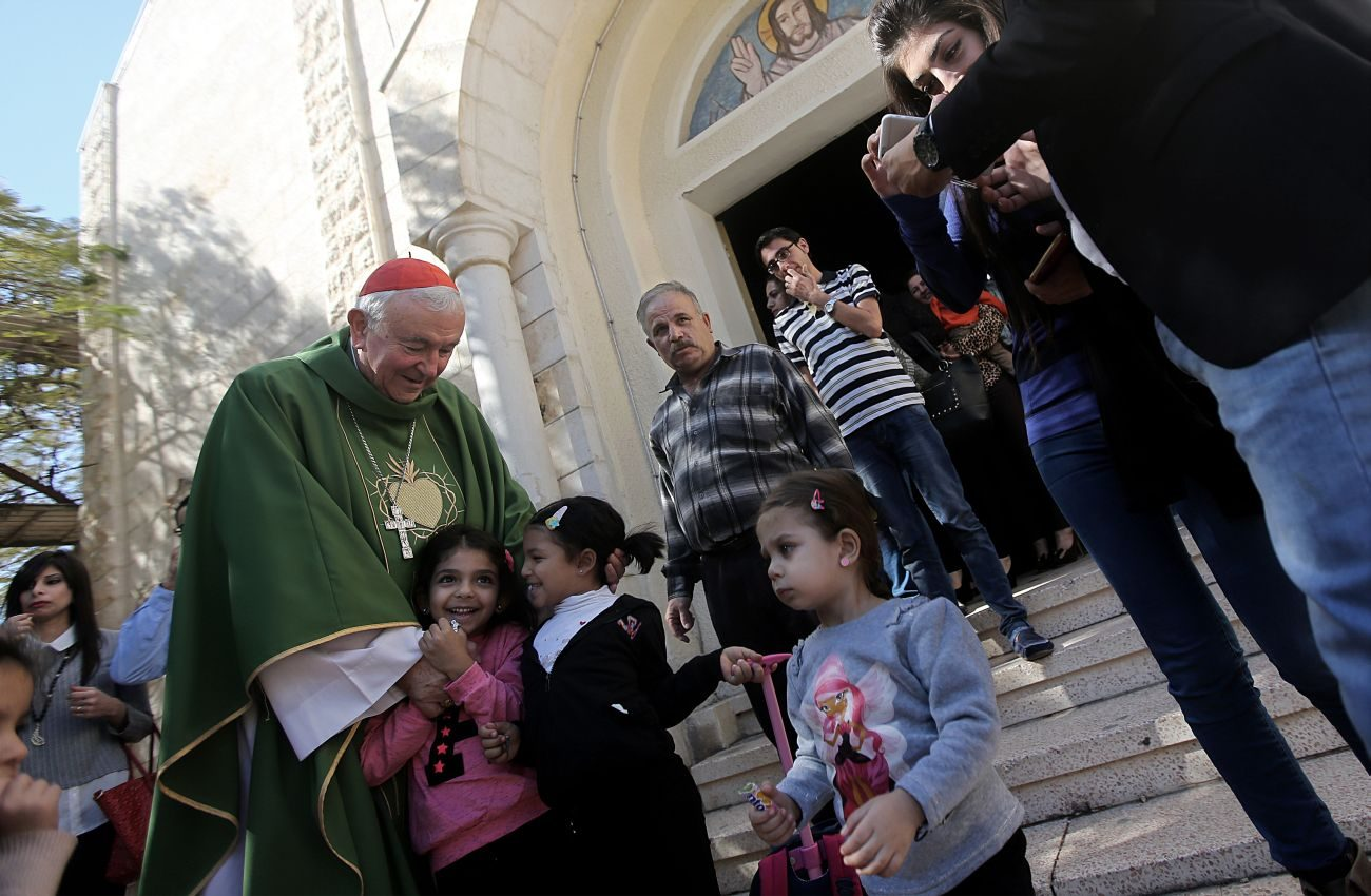 Cardinal Vincent Nichols of Westminster, England, greets children after celebrating Mass Nov. 6 at Holy Family Church in Gaza City. The cardinal said his pastoral visit reinforced the importance of Christian hope, especially for those living in very insecure circumstances. (CNS photo/Mohammed Saber, EPA)